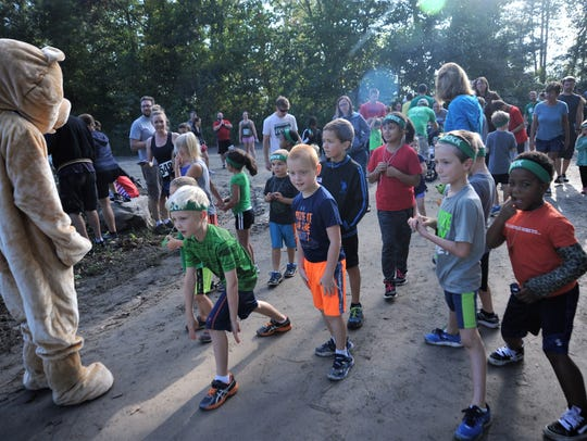 Children 10 and under prepare for the fun run at Grove Stone & Sand Co. last year. The quarter-mile run precedes the Rock the Quarry Trail Challenge 5K, which returns for year 11 on Saturday, Sept. 15.