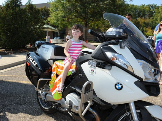 Mia Moeller was ready to hit the road on this Farmington Hills Police motorcycle.