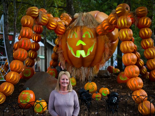 Mona Norton of Limestone, Tenn. poses for a photo at Dollywood's new nighttime fall experience, Great Pumpkin LumiNights Thursday, Sept. 28, 2017. Great Pumpkin LumiNights will run Sept. 29 through Oct. 28.