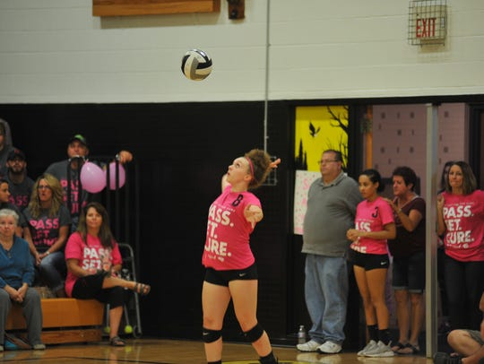 Freshman Alyssa Sallee serves in the first game for
