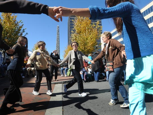 Visitors to HardLox, Asheville's Jewish Food and Heritage Festival, dance to the music of the Goldstein Family Band in 2012.