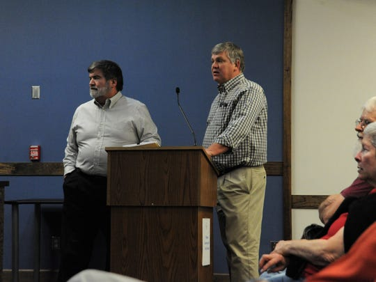 Mike Begley, left, the attorney for the Trestle Crossing development, and project architect Maury Hurt present their case to the Historic Preservation Commission.