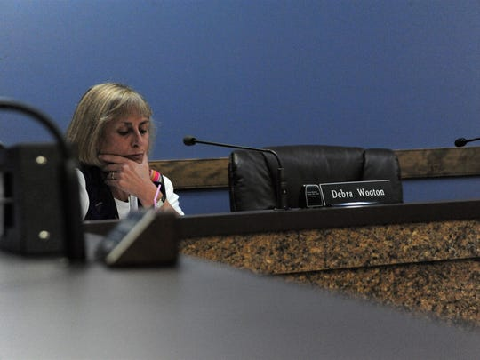 Historic Preservation Commission chairwoman Debra Wooton considers the Trestle Crossing case next to a the empty seat normally filed by commissioner Shanda Richardson.