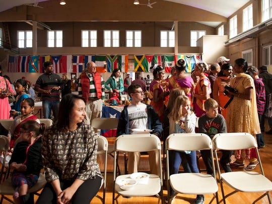 Visitors gather in the Ribeyre Gymnasium in New Harmony for the 2016 Global Crossroads Festival.