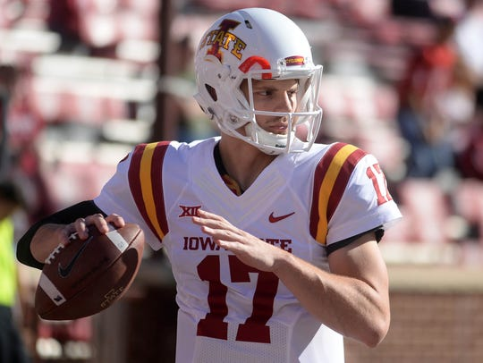 Iowa State Cyclones quarterback Kyle Kempt (17) warms
