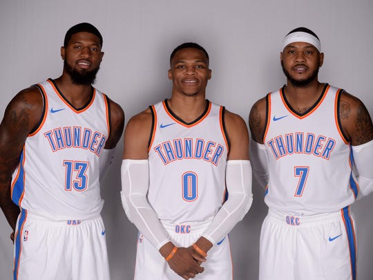 Thunder players Paul George (13), Russell Westbrook (0) and Carmelo Anthony (7)  pose for photos during media day.