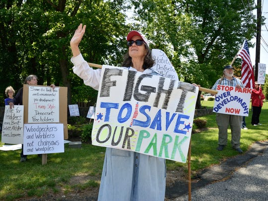 Protesters rallied against a proposed disc golf course in Rifle Camp Park in the spring.
