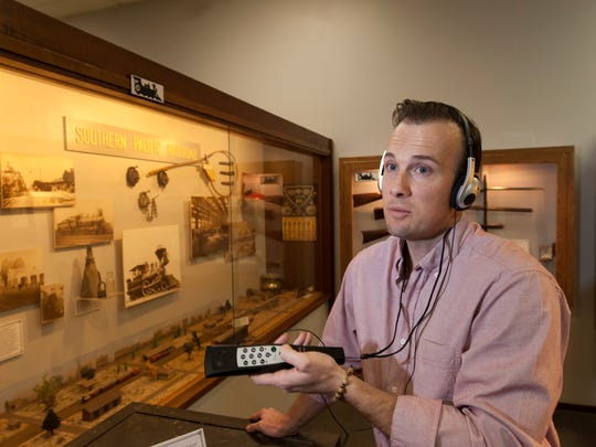 Tulare Historical Museum curator Chris Harrell demonstrates one of the pre-recorded audio guides now available to visitors. There are 85 tracks that can heard in any order and feature voices of historical residents includint that of the Hillman and Heiskell Family.