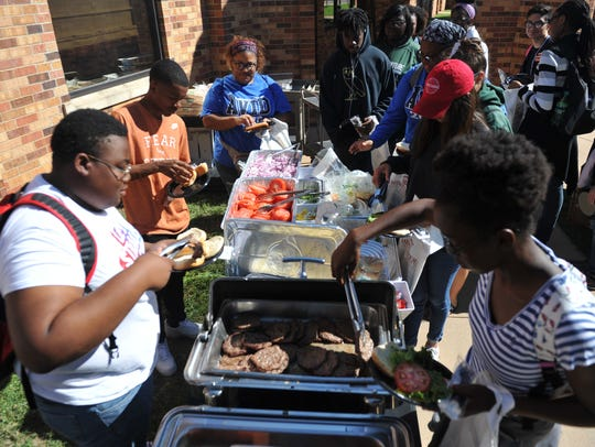 Students line up for hamburgers and hotdogs during