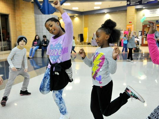 Girls dance during breaks between activities at Girls: Embrace Your Body.
