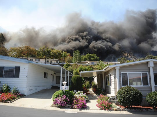 Flames spread near The Springs Dedication Park during a fire in Camarillo Springs.