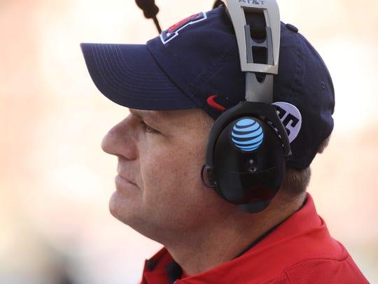 Arizona Wildcats head coach Rich Rodriguez looks on