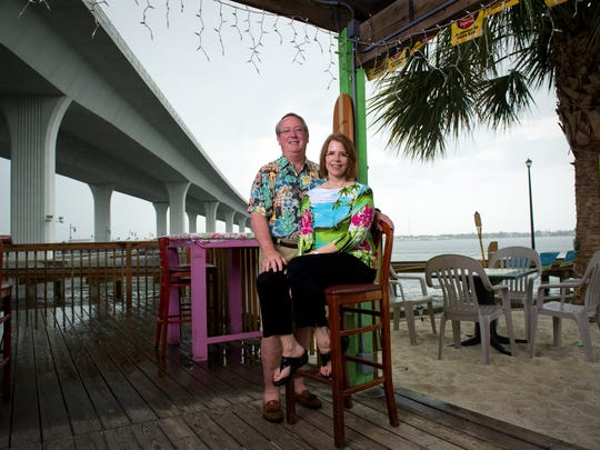 Paul and Linda Daly, seen in 2012, own The Pelican Cafe located near the south end of the Roosevelt Bridge and recently sold The Flagler Grill in downtown Stuart.