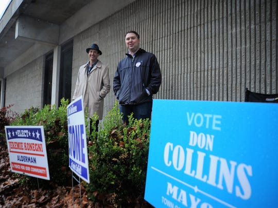 Ryan Stone, right, and Weston Hall stand outside of Black Mountain Primary School on Nov. 7 and greet voters as they head to the polls.