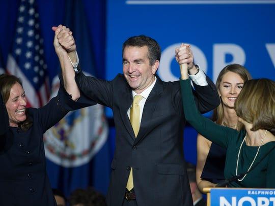 Ralph Northam celebrates after his gubernatorial election