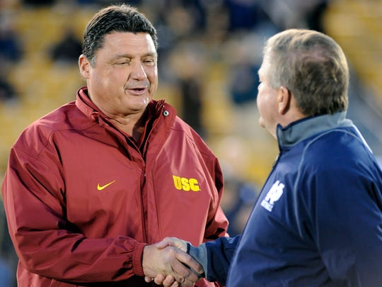 Southern California interim coach Ed Orgeron, left,