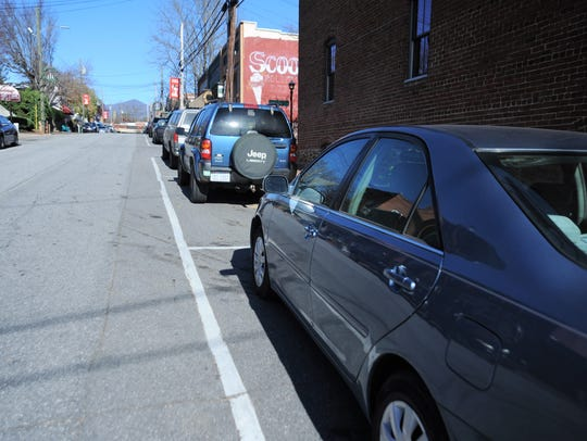 At 10:50 a.m. Nov. 16, 30 of 43 nonhandicap parking spaces on Cherry Street were full, despite many stores not opening until 11 a.m.