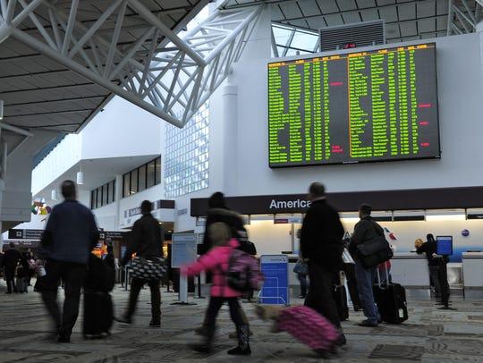 Travelers make their way through the Metro Nashville