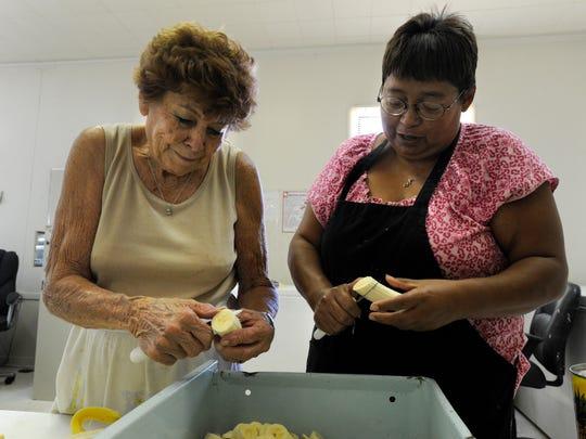 Sylvia Moreland (left) and Pat Seballos slice bananas for a fruit salad Thursday at the Anson Meals on Wheels Thursday, July 14, 2011. Moreland, 89, died Saturday Nov. 18, 2017.