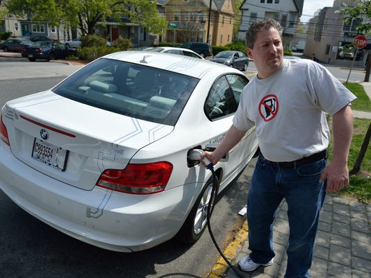 """""""The biggest electric car meet-up in New Jersey's history"""" Sponsored by the N.J. Electric Auto Association and Nauna's Bella Casa Ristorante of Montclair."""