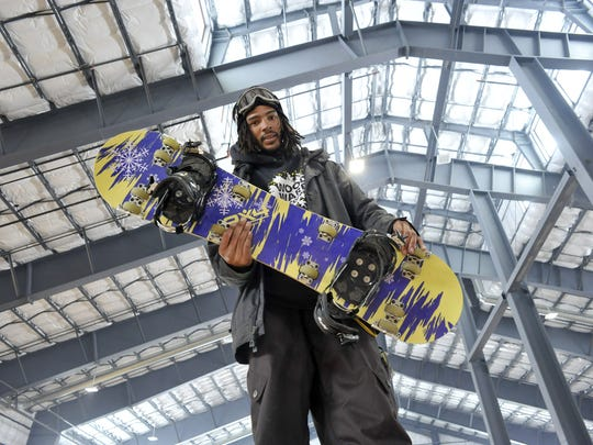 Brandon Hollins holds up a park board, which is, basically, a snowboard with wheels at Woodward Tahoe in 2012.