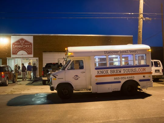 The Knox Brew Tours bus sits waiting for tour members