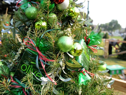 We Olive's tree is part of the Candy Cane Forest at Holidays at the Plaza, taking place in Plaza Park in downtown Ventura.