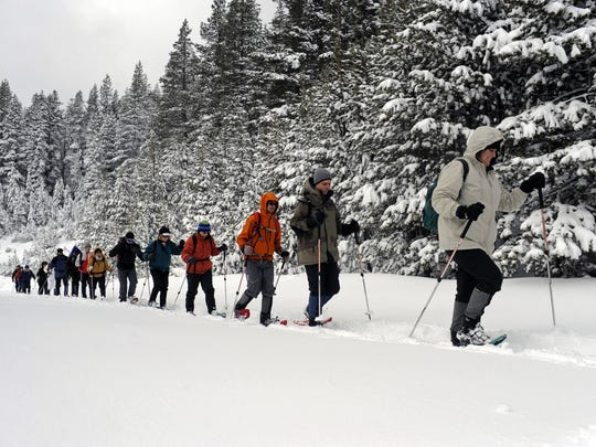 Beginning snowshoers taking part in an REI Outdoor School class head into the wilderness on a trail near Boreal in 2009.