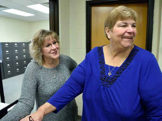 Little Ferry Councilwoman Roberta Henriquez, right, who is retiring after 30 years of service, reminisces about old times with Borough Clerk Barbara Maldonado.