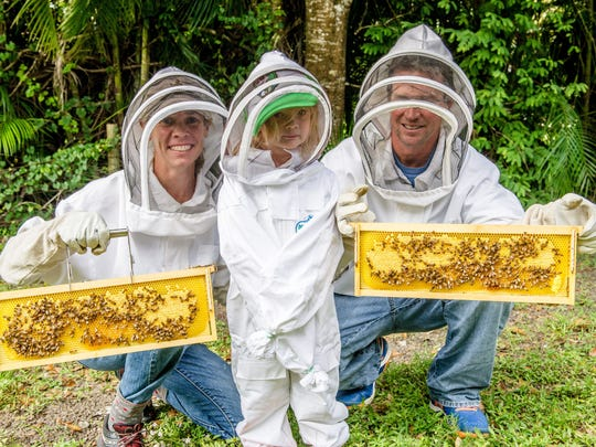 While a challenge, becoming bee keepers has made the Cardens feel more connected to the environment and the circle of life. Of utmost importance has been involving their 3-year-old daughter Zephyr, pictured center, to the bees