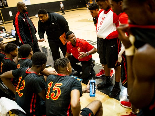 Deerfield Beach gathers during a timeout in the semifinals of the Gulfshore Holiday Hoopfest at Golden Gate High School on Friday.