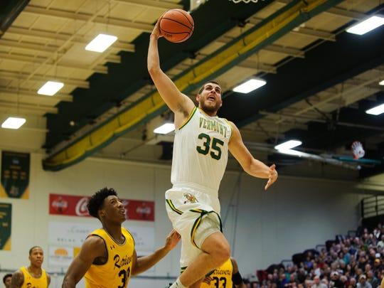 Vermont's Payton Henson (35) leaps to dunk the ball