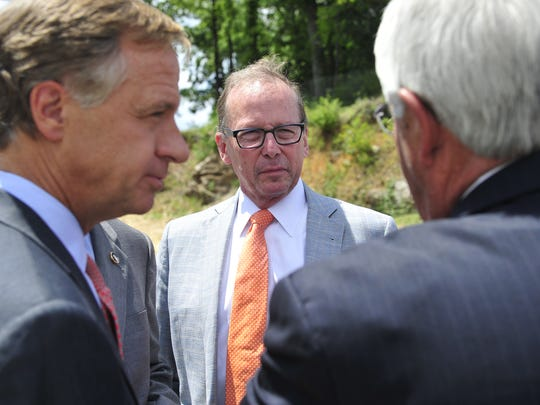 Gov. Bill Haslam and TDOT Commissioner John Schroer speak during a ribbon-cutting ceremony of the $23.4 million widening project of Mack Hatcher Parkway in Franklin on July 16, 2014.
