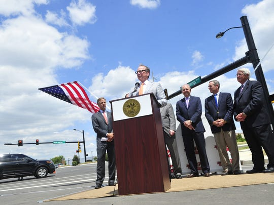 Gov. Bill Haslam and TDOT Commissioner John Schroer during a ribbon-cutting ceremony of the $23.4 million widening project of the Mack Hatcher Parkway in Franklin, Tenn., Wednesday, July 16, 2014.