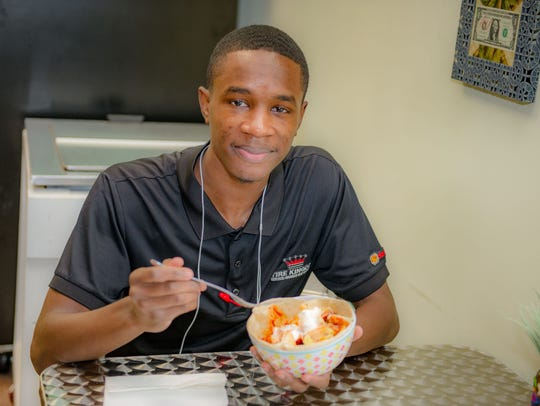 Customer Andre Smith eats lunch at Papa Kwans every