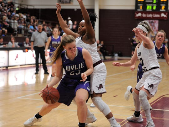 Wylie's Sarah Wolfe (23) battles underneath the basket at Brownwood on Tuesday, Jan. 23, 2018. The Lady Bulldogs earned the 50-44 road win.