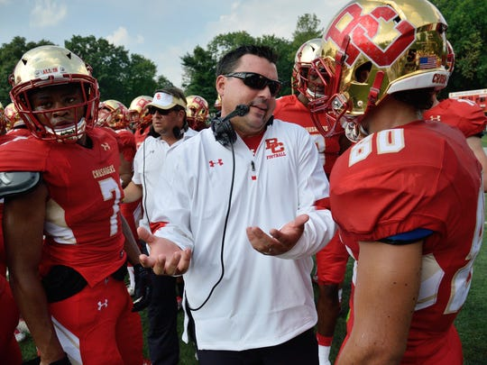 Bergen Catholic's coach Nunzio Campanile, center, speaks to his team during a game against Tampa Catholic in Oradell in 2016.