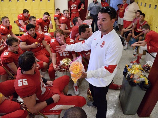 Bergen Catholic coach Nunzio Campanile speaks to his team at halftime during a 2016 game against Tampa Catholic in Oradell.
