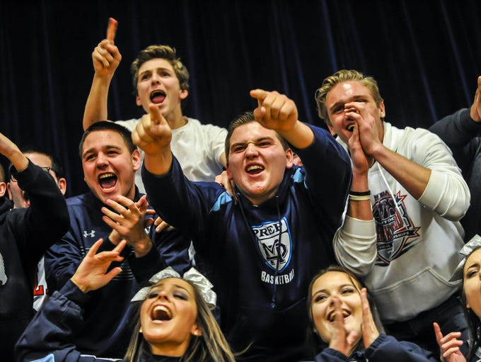 Mater Dei Prep fans cheer during a game against Ranney