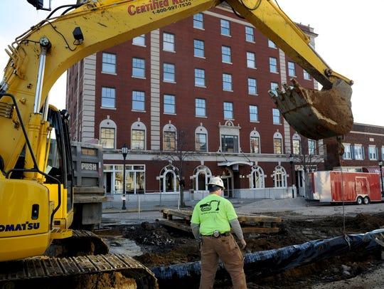 Garney Construction worker Ben Lapp helps prepare a