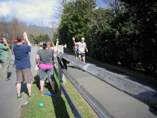 Runners in the 2018 Mount Mitchell Challenge and Black Mountain Marathon make their way along the Flat Creek Greenway as residents cheer them on.