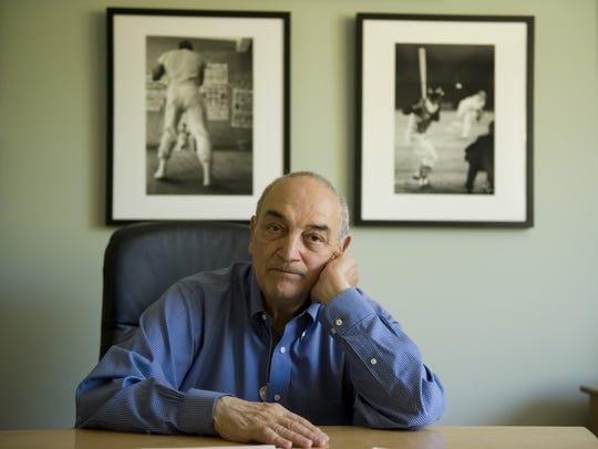 Sonny Vacarro, a retired shoe company executive, poses