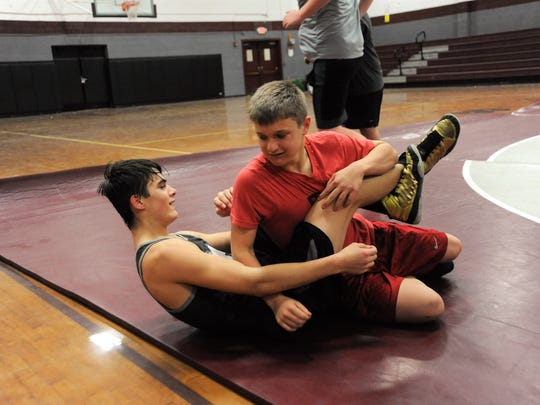 Jason Dash, in red, joined the Grove Stone Wrestling Club last year with no prior experience in the sport before posting a 13-1 record as a member of the Owen Middle School team this winter.