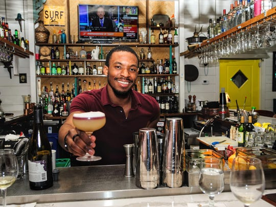 New York sours (made with whiskey, simple syrup, lemon juice, egg whites and Shiraz) are among Nage bartender Sean Norris' specialties.