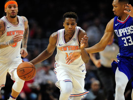 New York Knicks guard Frank Ntilikina (11) moves the ball against Los Angeles Clippers forward Wesley Johnson (33) during the first half at Staples Center.
