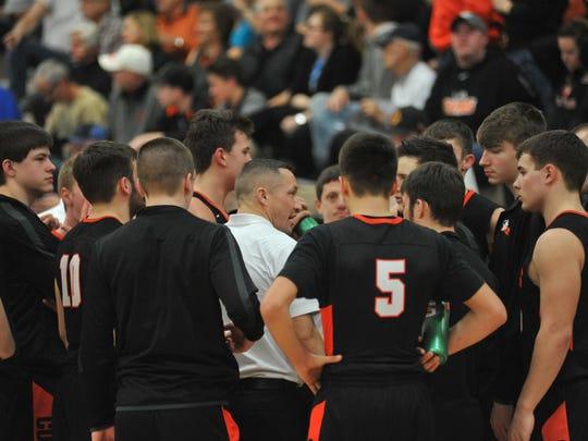 Lucas coach Taylor Iceman huddles with his team.