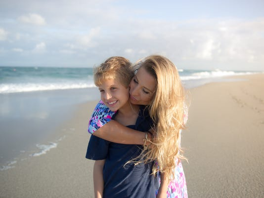 0315-JCNW-Jack-and-mom-Jen-Nolin-on-Jupiter-beach.jpg