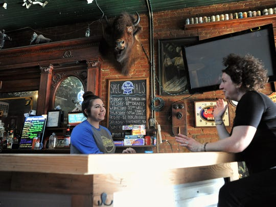 Town Pump bartender Melissa Lees talks to customer Amy McGillicuddy, a regular at the Cherry Street bar, on a recent Sunday afternoon.