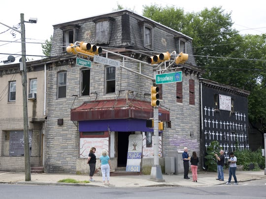 In 2013, the building that is now the Nick Virgilio Writers House was blighted and marked by crosses signifying people murdered in Camden.