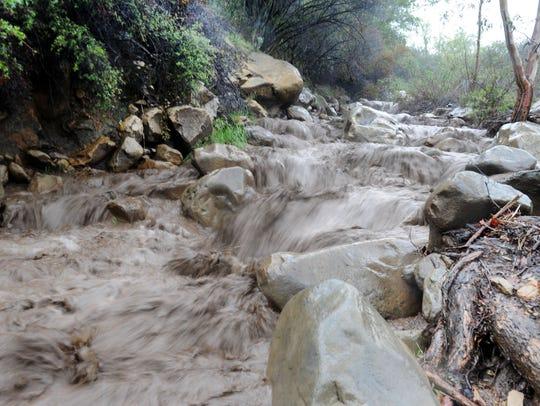 Water was raging down Pratt Trail in Ojai as the storm